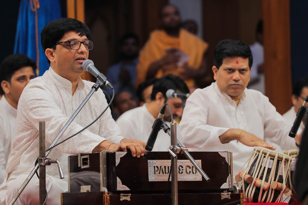 Youths sing kirtans in the evening Sunday satsang assembly