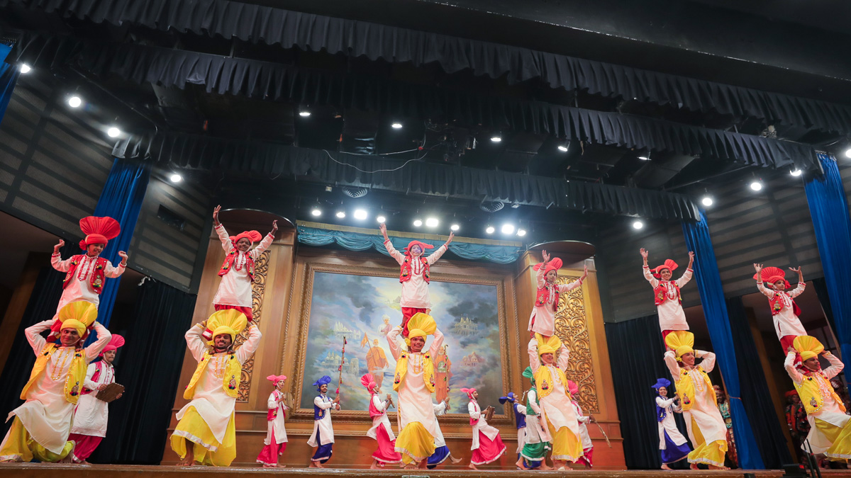 Children and youths perform a traditional dance