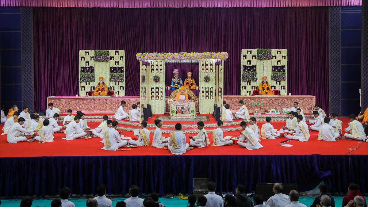 Children sing and perform the mahapuja