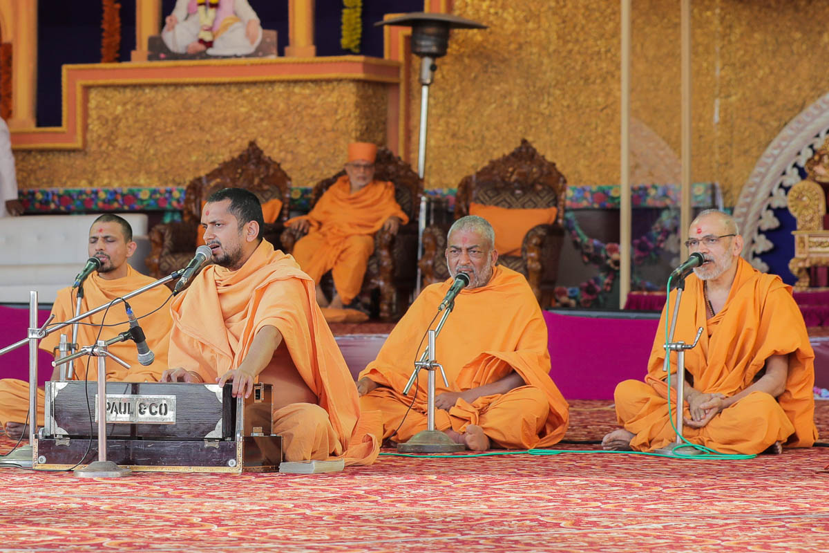 Sadhus sing kirtans during the murti-pratishtha assembly in the evening