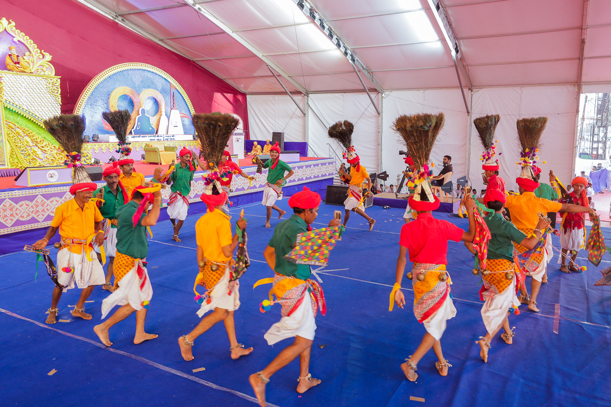 Tribal devotees perform a traditional tribal dance