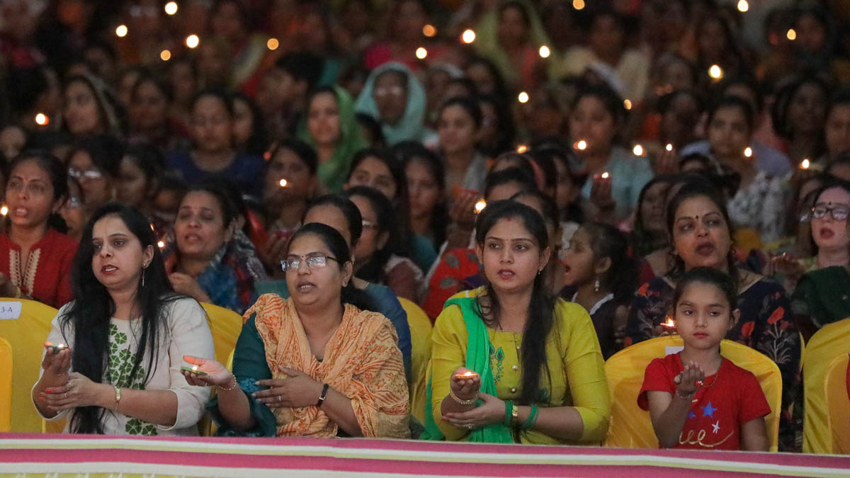 Devotees perform the arti