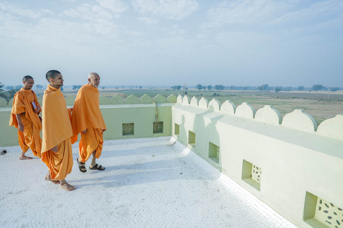 Swamishri walking in the afternoon on the terrace