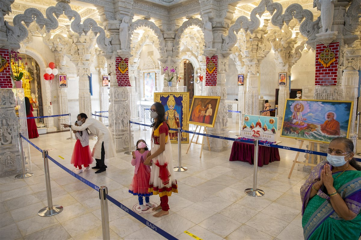 Devotees stand on designated spots for darshan