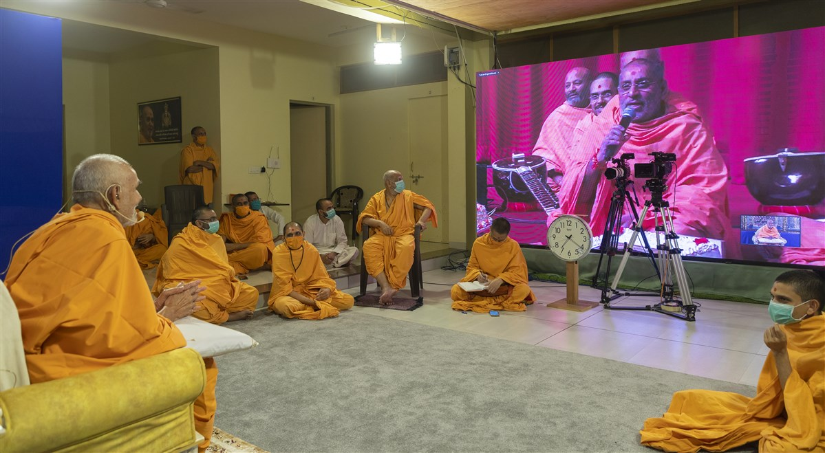 Swamis in London interacted with Swamishri via the video conference facility