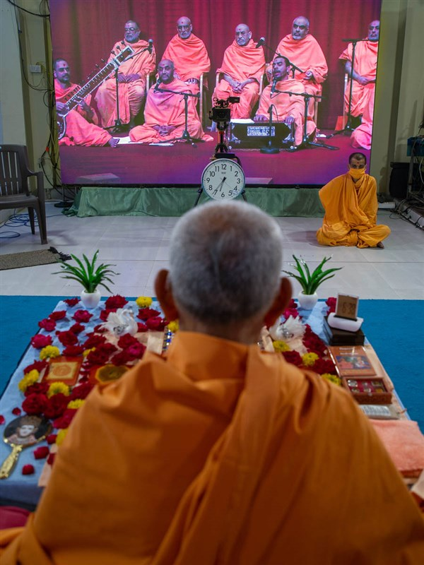 Sadhus sing kirtans via video conference from London Mandir