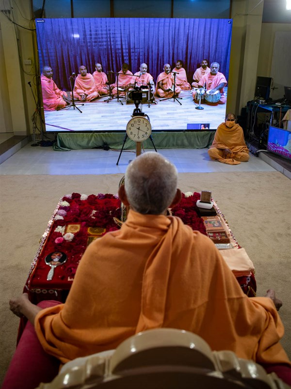 Sadhus sing kirtans via video conference from Tithal Mandir