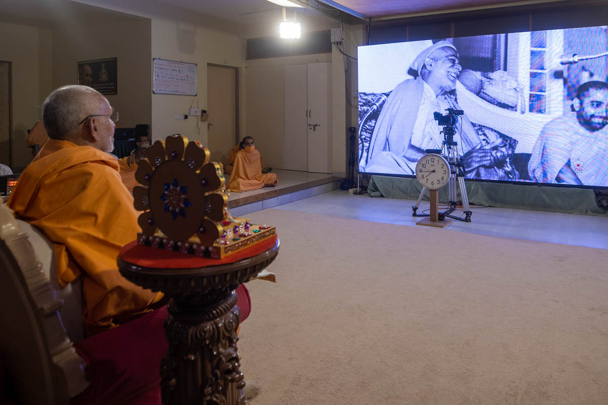 Swamishri watches a video presentation
