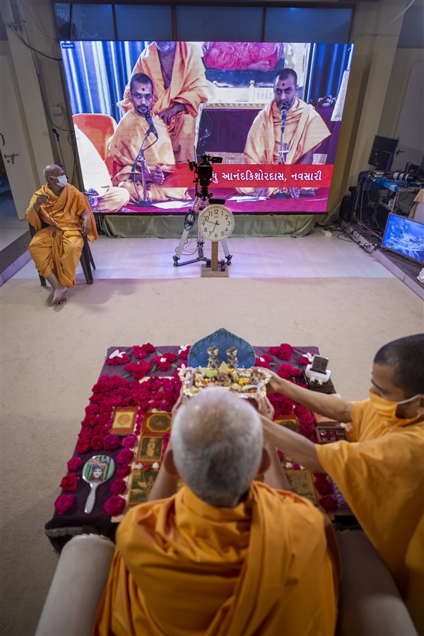 Sadhus sing kirtans via video conference from Navsari Mandir