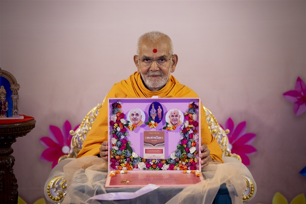 Swamishri with the invitation card