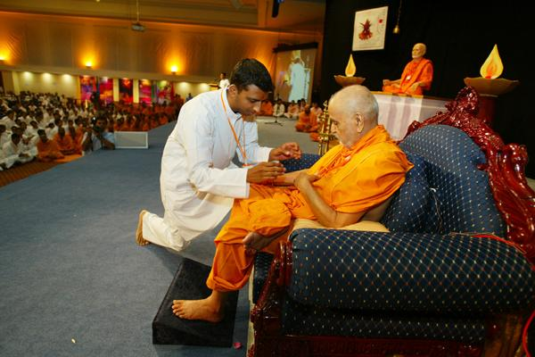 Day 1 - National Kishore-Kishori Summer Shibir  - Swamishri presented with the ID badge of the Shibir
