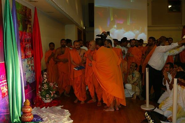 Swamishri viewing the exhibition prepared by kishores