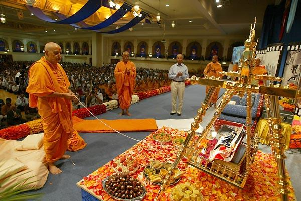 Janmasthami and London Mandir Patotsav Ceremony  - Swamishri devotionally swings Thakorji on a golden swing