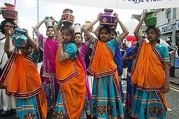 Young girls take part in the Rath Yatra wearing colourful saris