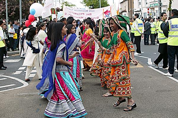 Girls dressed in traditional outfits dance in the Rath Yatra
