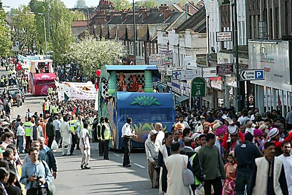 The beautifully decorated chariots passing through Ealing Road