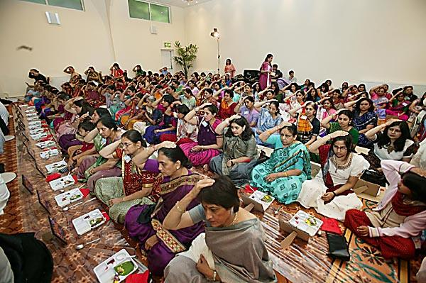 Devotees participating in the mahapuja vidhi