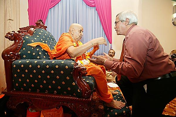 Lord Dholakia, President of the Liberal Democratic Party garlands Swamishri
