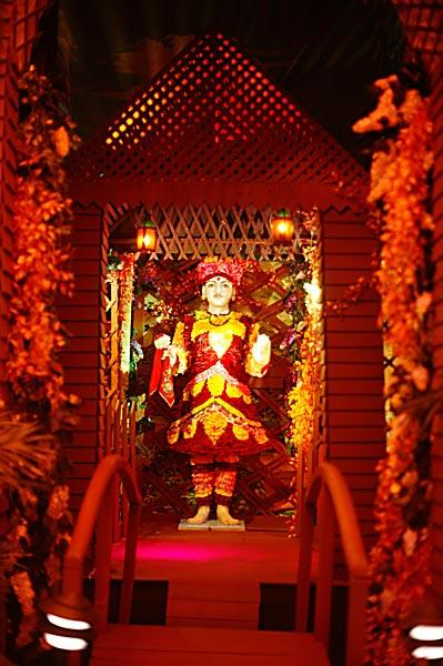 Ghanshyam Maharaj is beautifully adorned with flowers