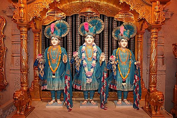 Colourful garments offered to the sacred images of Dham, Dhami and Mukta