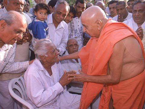 Blessing an ailing devotee