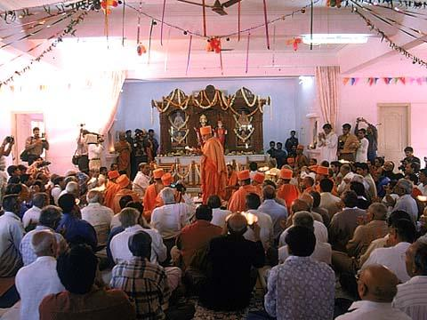 Performing Arti after the Murti Pratishtha ceremony