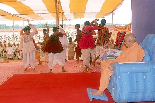 Youths perform a traditional dance