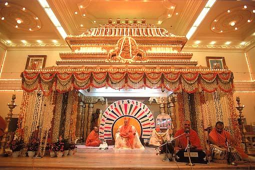 The grand decorated stage of the Kalyan Mandap assembly hall