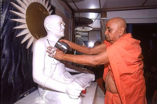 Performing abhishek on the murti of Shastriji Maharaj at the birth place