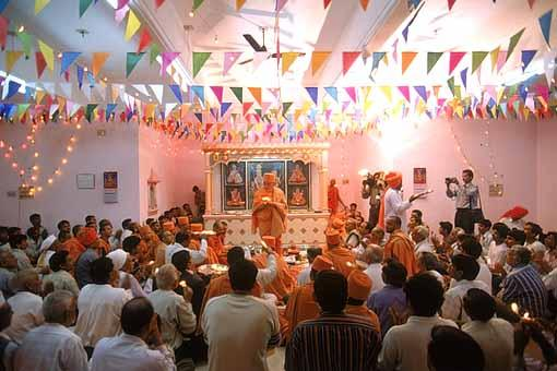 Swamishri and devotees performing arti after the murti pratishtha ceremony