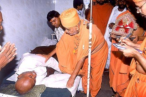 Blessing a patient at the Sanstha's Vadodaria Hospital