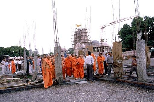 At the age of 80 years Swamishri walks through the uneven, rough surface to see and observe every part of the construction work and correct any aspect that has been overlooked