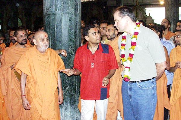 Blesses a wellwisher and explains about the glory of Yogiji Maharaj