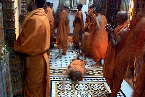 Sadhus prostrate before the deities during Mangala arti