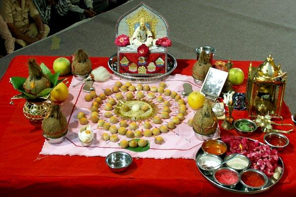 Thakorji in Mahapuja with symbolic representation of deities and muktas