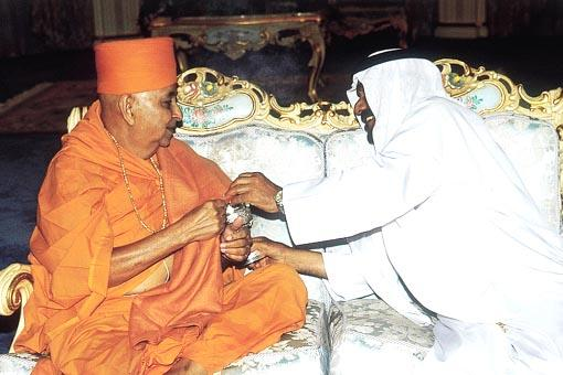 The Sheikh holds the incense as a mark of respect