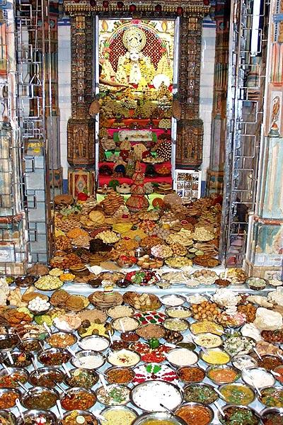 Varieties of vegetarian food items offered to the murtis in each of three shrines of the main mandir