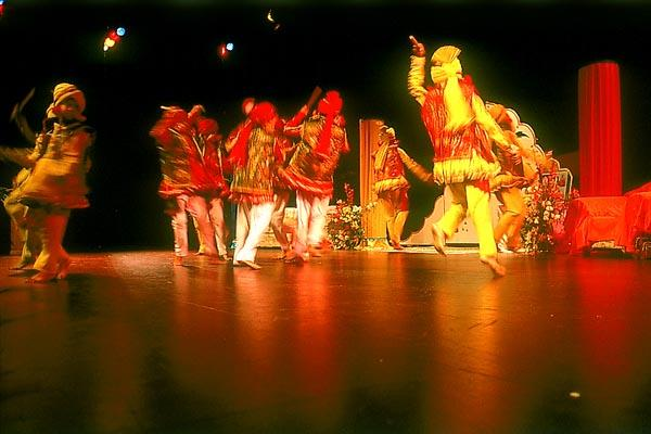 Youths perform a traditional raas dance during the evening assembly at Penhrose College