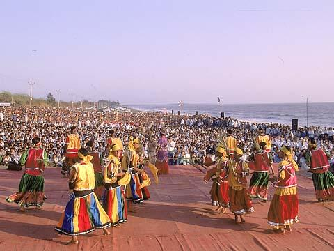 Fishermen youth performing a dance during the mammoth assembly, Kosamba