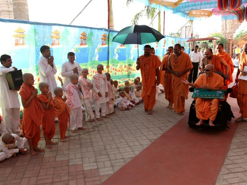 Kids perform a skit before Swamishri