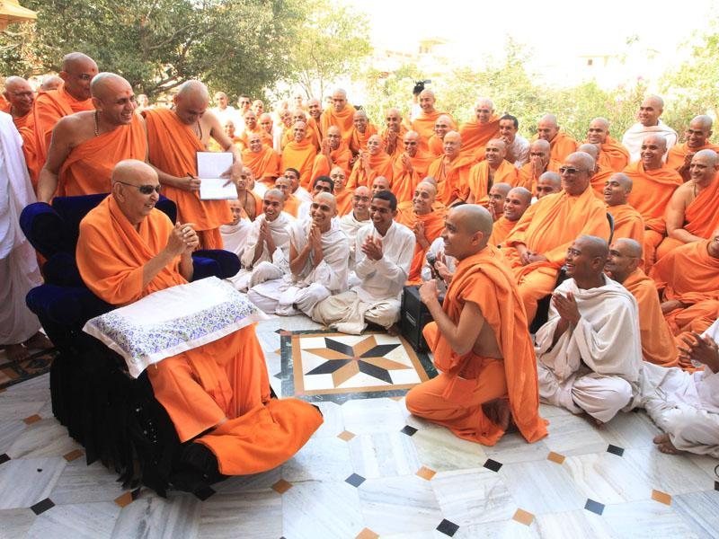 A presentation before Swamishri in the Smruti Mandir pradakshina
