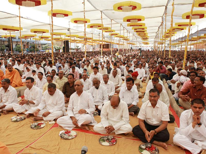 Fathers of sadhaks participate in  mahapuja at the diksha ceremony