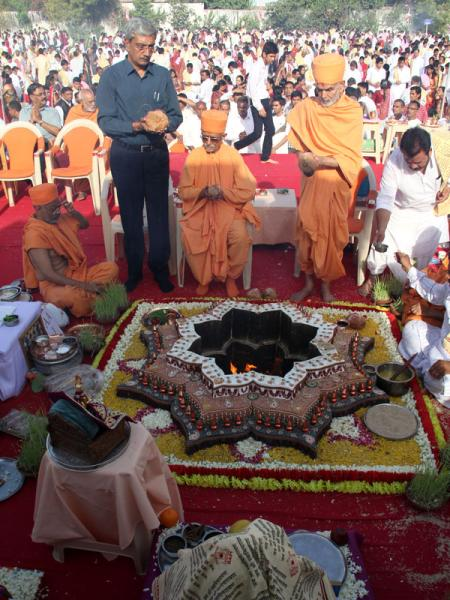 Pujya Mahant Swami, Pujya Doctor Swami and the Mayor of Ahmedabad engaged in mahayagna rituals