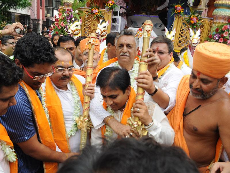 Traditional pujan ritual of sweeping the road with a golden broom, performed by distinguished guests