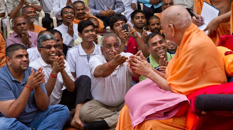 Swamishri and devotees in a jovial mood