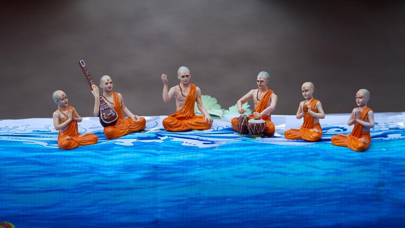 Small figures of sadhus adorn the pond