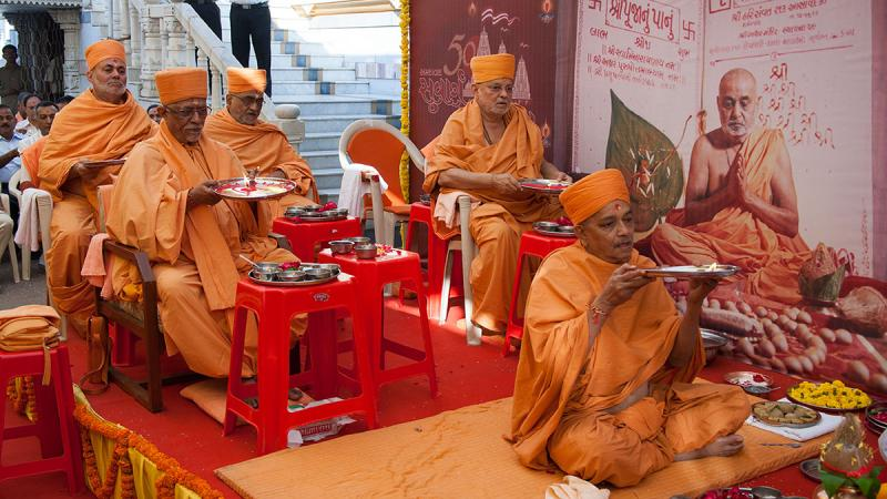 Senior sadhus perform chopda pujan arti