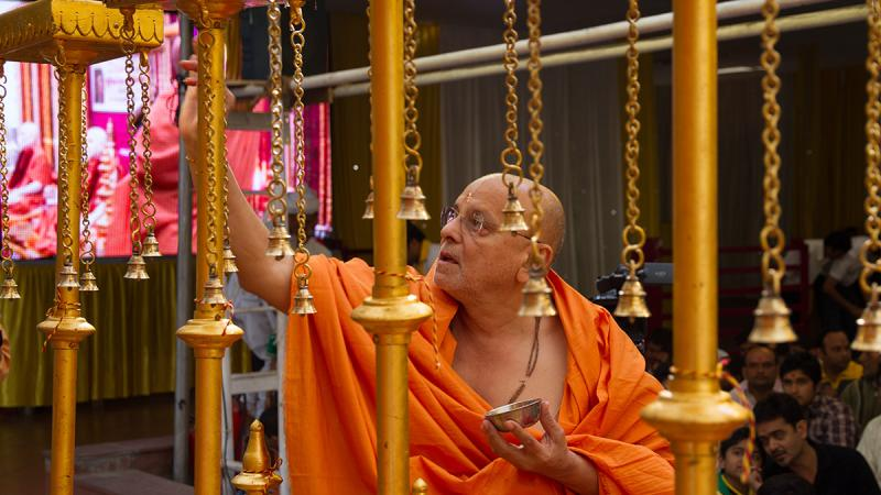 Pujya Ishwarcharan Swami performs pujan of flagstaffs