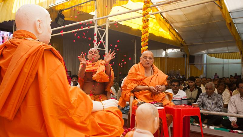 Senior sadhus perform mahapuja rituals
