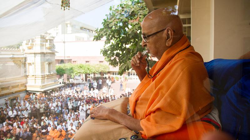 Swamishri blows a whistle